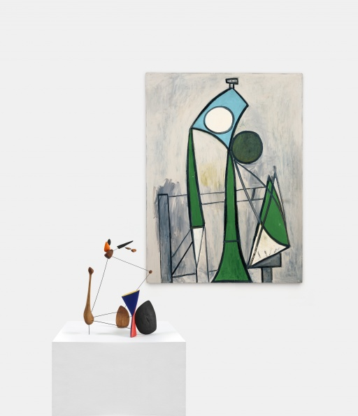 """Alexander Calder / Constellation with Diabolo. 1943. Wood, wire, and paint. 24 1/4"""" x 18 1/4"""" x 16"""". © 2016 Calder Foundation, New York / Artists Rights Society (ARS), New York.  Pablo Picasso / Femme dans un fauteuil. June 8, 1946. Oil on plywood. 51 1/8"""" x 38 1/8"""". Zervos XIV-175 © 2016 Succession Picasso / Artists Rights Society (ARS), New York."""
